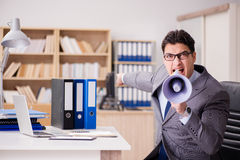 The businessman with loudspeaker in the office Stock Photos