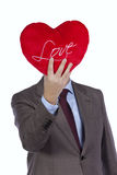 Businessman with love heart face Royalty Free Stock Image