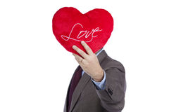 Businessman with love heart face Stock Images