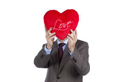 Businessman with love heart face Stock Photo