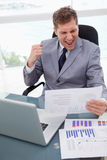 Businessman loves the result of market research Stock Images