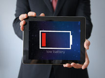 Businessman with low battery tablet Royalty Free Stock Images
