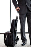 Businessman with luggage Stock Photos