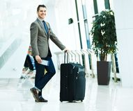 Businessman with luggage Stock Photography