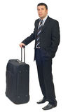 Businessman with luggage waiting Stock Images