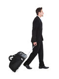 Businessman With Luggage Walking Over White Background Royalty Free Stock Photo