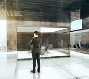 Businessman in luxury office with conference room. 3D Render Royalty Free Stock Images
