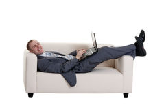 Businessman lying on the couch Royalty Free Stock Photography