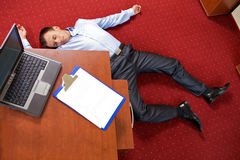Businessman lying on the floor Stock Photography