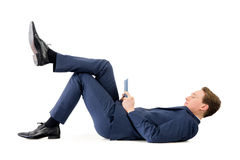 Businessman lying on the floor Royalty Free Stock Images