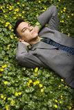 Businessman Lying in Flower Patch royalty free stock images