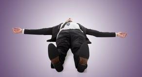 Businessman lying on ground royalty free stock image
