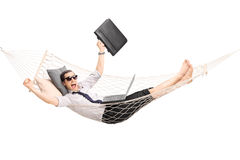 Businessman lying in a hammock and gesturing joy Stock Image