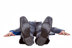 Businessman lying on his back isolated Stock Images