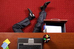 Businessman lying in the office Royalty Free Stock Photo
