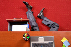 Businessman lying in the office Stock Images