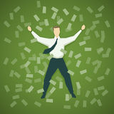 Businessman lying in a pile of money Stock Images