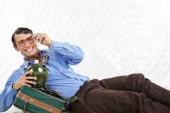 Businessman Lying With Travel Bag Royalty Free Stock Photo