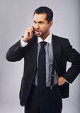 Businessman Mad at Someone Over the Phone Royalty Free Stock Images