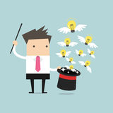 Businessman with Magic Hat Full of Light Bulbs (Ideas) Royalty Free Stock Photo