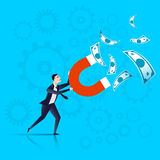 Businessman with a magnet in his hands attracts money, businessman attract capital investment - business concept.  Stock Photography