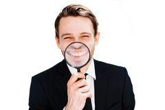 Businessman with a magnified smile Stock Photography