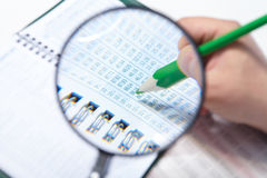 The businessman and magnifier. Businessman working in the office. The magnifier Stock Photography