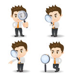 Businessman with magnify glass Royalty Free Stock Image