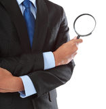 Businessman with magnifying glass Stock Photos