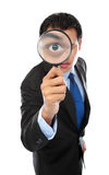 Businessman with magnifying glass Royalty Free Stock Image
