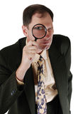 Businessman with a magnifying glass Royalty Free Stock Images
