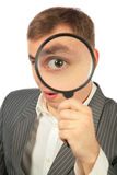 Businessman with magnifying glass royalty free stock photos