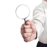 Businessman with magnifying glass Stock Images
