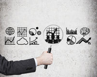 Businessman with magnifying glass l. Ooking at graphs and charts Royalty Free Stock Photography