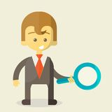 Businessman with a magnifying glass looking for Royalty Free Stock Photography