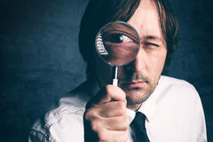 Businessman with magnifying glass, tax inspector doing financial Royalty Free Stock Photos