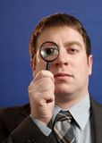 Businessman With Magniying Glass Stock Photo