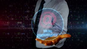 Businessman with at mail cloud hologram. Man with mail at symbol hologram on hand. Businessman showing futuristic concept of internet communication stock video footage