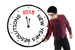 Businessman make clock for his resolution time Stock Photography