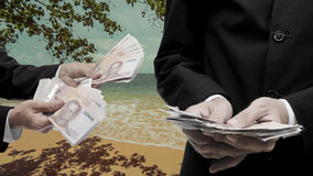 Businessman make money from beach Royalty Free Stock Image