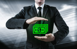 Businessman make money and save money on virtual screens. Business, technology, internet, concept. Stock Photo