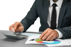 Businessman makes calculations. Stock Photo