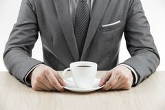 Businessman makes coffee break Royalty Free Stock Photo