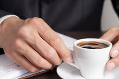 Businessman makes coffee break Royalty Free Stock Photos