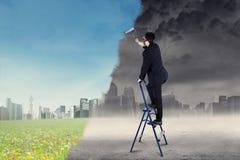Businessman makes green living banner stock photo
