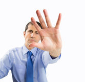 Businessman makes halt sign Stock Images