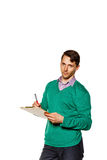 Businessman makes note in checklist. Stock Photos