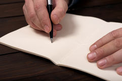 Businessman makes a note at notebook Royalty Free Stock Photos