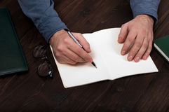 Businessman makes a note at notebook Royalty Free Stock Photography
