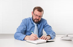 Businessman makes notes Stock Photography